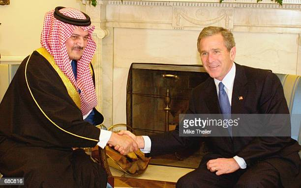S President George W Bush shakes hands with Saudi Arabia's Foreign Minister Prince Saud al Faisal November 9 2001 as they meet in the Oval Office...