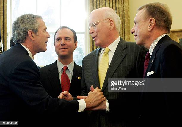 S President George W Bush shakes hands with Sen Arlen Specter as Sen Patrick Leahy and Rep Adam Schiff look on after a signing ceremony in the Oval...