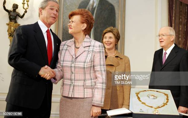 US President George W Bush shakes hands with the President of Lativia Vaira VikeFreiberga after she awarded Bush The Three Star Order First Class...