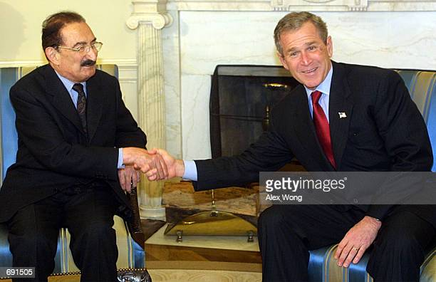 U S President George W Bush shakes hands with Turkish Prime Minister Bulent Ecevit during their meeting January 16 2002 at the Oval Office of the...