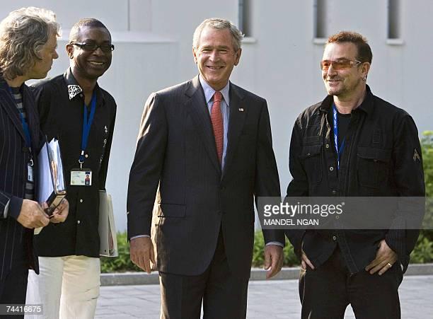President George W Bush shares a laugh with Irish environmental activist and U2 lead singer Bono and Irish political activist Bob Geldof and...