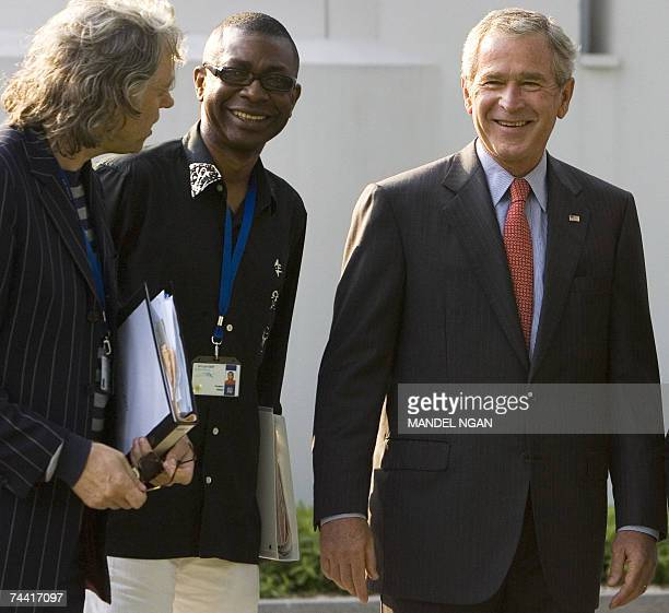 President George W Bush shares a laugh with Irish political activist and musician Bob Geldof and Senegalese Musician Youssou N'Dour 06 June 2007...