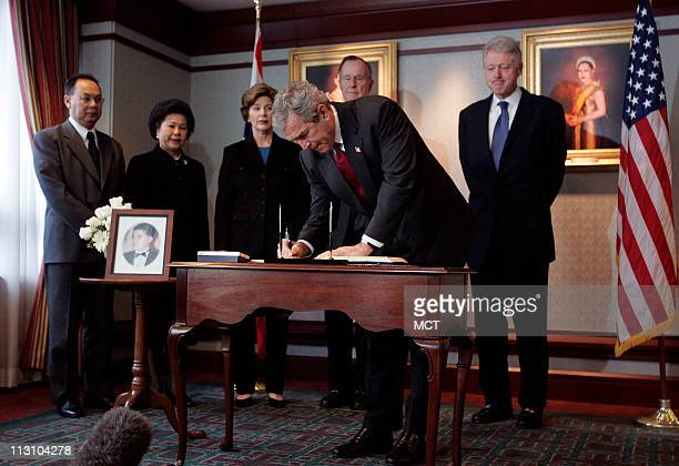 WASHINGTON DC US President George W Bush signs a book of condolences as first lady Laura Bush and former Presidents Bill Clinton and George H Bush...