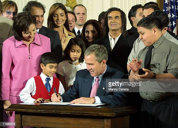 President George W. Bush signs an executive order for the purpose of increasing academic performance of Hispanic American students and closing the...