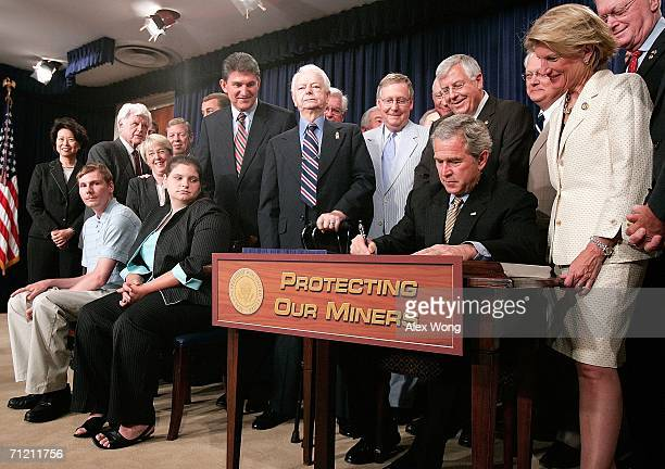 S President George W Bush signs the Miner Act into law as Randy McCloy the sole survivor of the Sago Mine accident on January 2 his wife Anna...