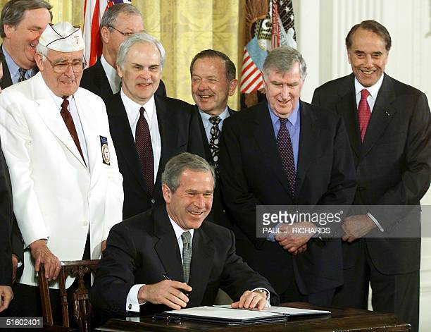 President George W Bush signs US House of Representatives Resolution 1696 legislation expediting the construction of the World War II Memorial on the...