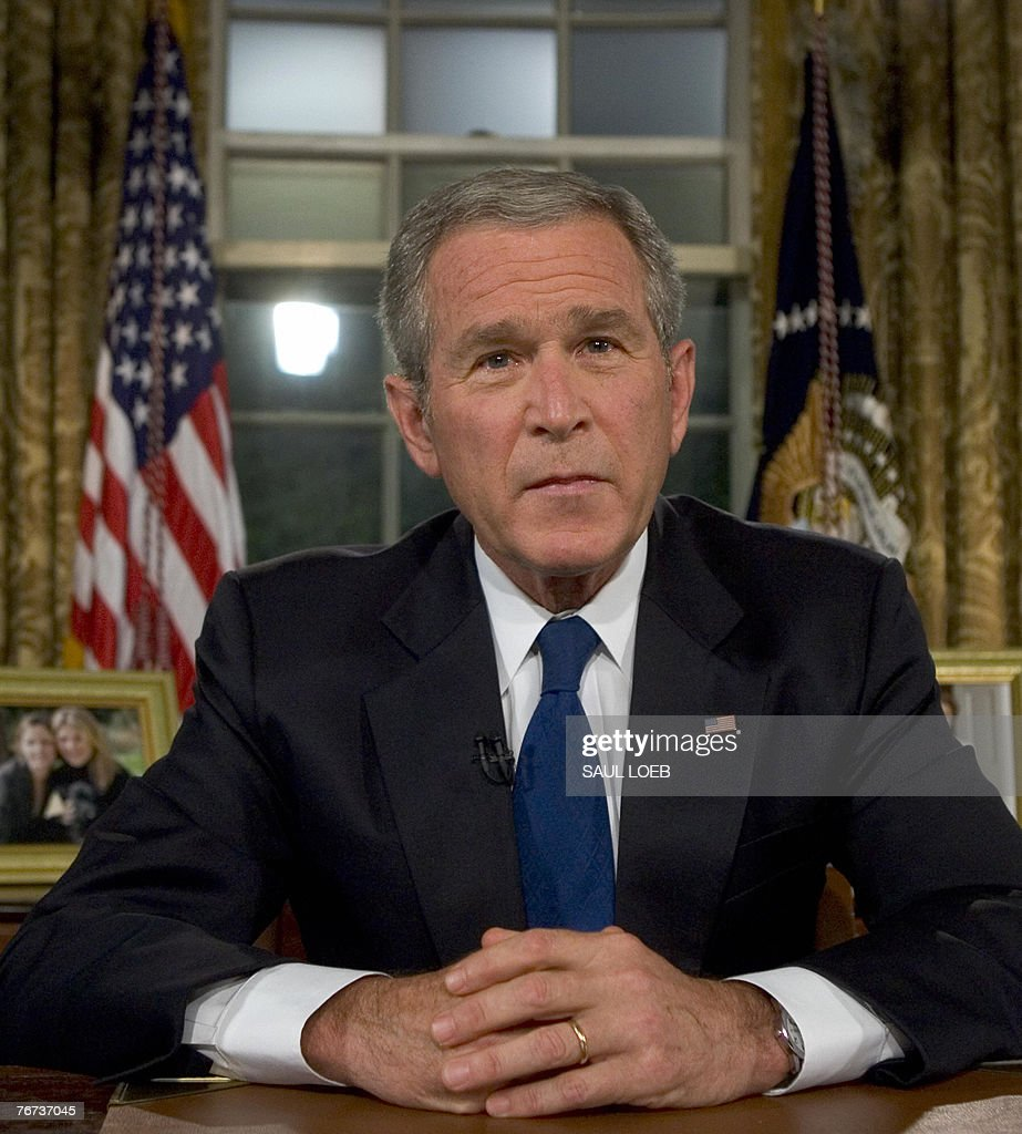 president in oval office. US President George W. Bush Sits At His Desk In The Oval Office Of
