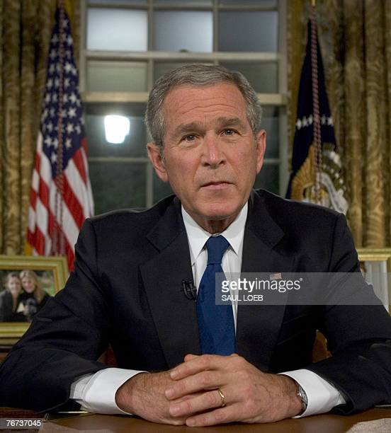 US President George W Bush sits at his desk in the Oval Office of the White House 13 September 2007 in Washington DC after a primetime speech...
