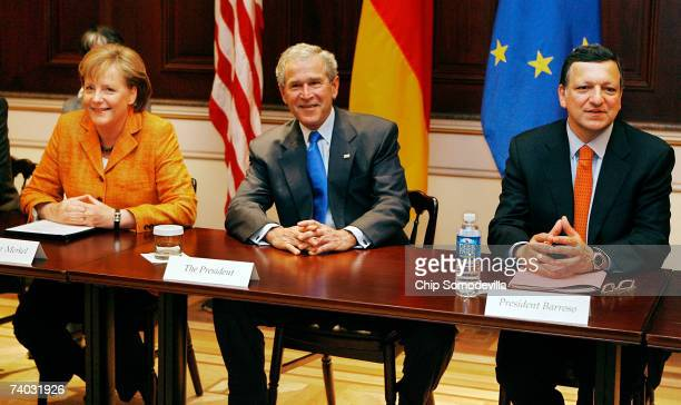 President George W Bush sits down with German Chancellor Angela Merkel and European Commission President Jose Manuel Barroso for a meeting of the...