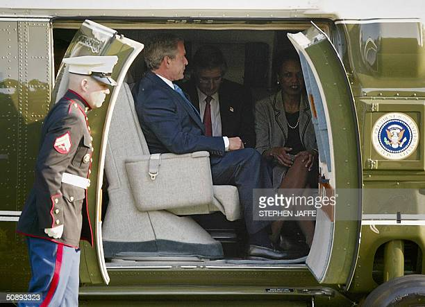 President George W Bush sits in Marine One with his Chief of Staff Andrew Card and National Security Advisor Condoleezza Rice as a Marine Guard...