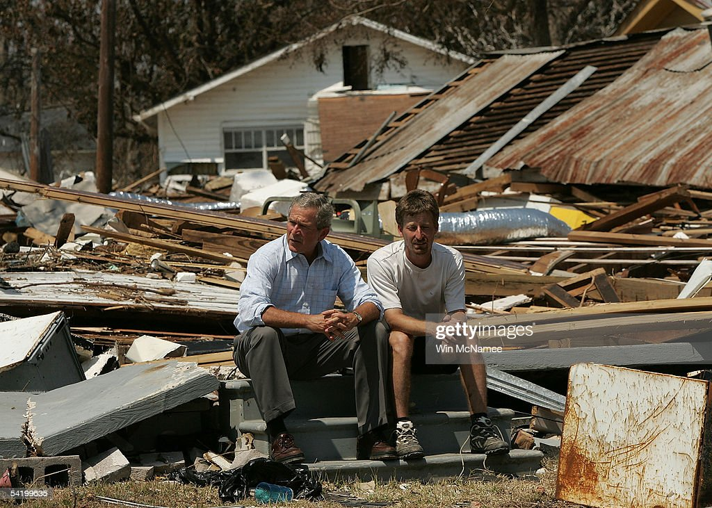 U.S. President George W. Bush (L) sits with Patrick Wright on the steps of what was his parents' house September 2, 2005 in Biloxi, Mississippi. Wright's parents survived the storm despite being inside the home while it was destroyed. Bush visited the town of Biloxi, in parts completely devastated, during his tour of the Gulf Coast to view damage caused by Hurricane Katrina.