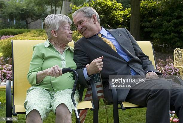 US President George W Bush sits with Ruth Harris after stopping his motorcade to wish her a happy 91st birthday in Gates Mills Ohio July 29 2008 AFP...