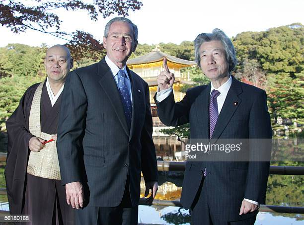 S President George W Bush smiles between High Monk Raitei Arima and Japanese Prime Minister Junichiro Koizumi on a walk through the grounds of...