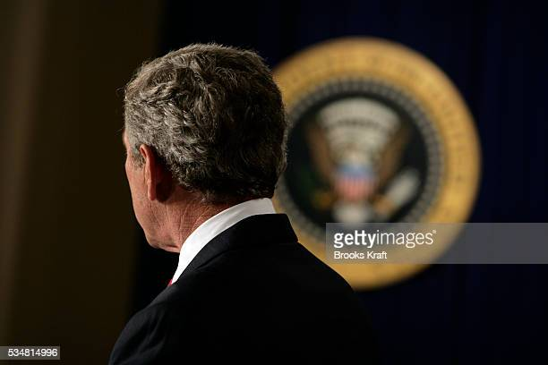 President George W Bush speaks about the economy in the Eisenhower Executive Office Building in Washington DC Bush predicted on Wednesday that strong...