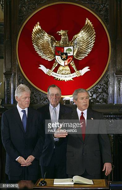 President George W Bush speaks after signing the condolence book for the victims of the tsunami disaster at the Indonesian embassy in Washington as...
