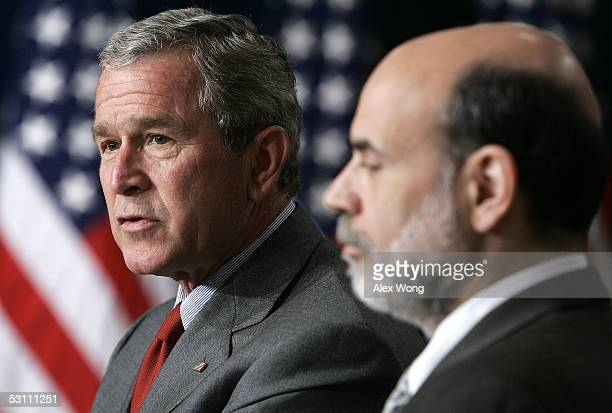 S President George W Bush speaks as Ben Bernanke listens after a swearing in ceremony June 21 2005 at the Eisenhower Executive Office Building of the...