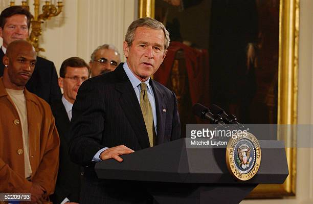 S President George W Bush speaks as Chauncey Billups of the Detroit Pistons listens while visiting the White House on January 31 2005 in Washington...