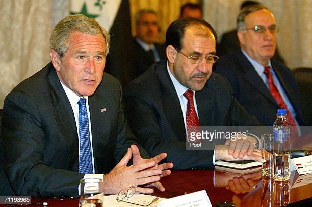 President George W Bush speaks as Iraqi Prime Minister Nuri alMaliki and his Defense Minister Abdel Kader Jassem alObeidi listen during their meeting...