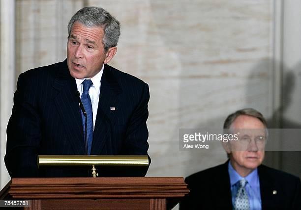 S President George W Bush speaks as Senate Majority Leader Sen Harry Reid listens during a Congressional Gold Medal presentation ceremony for...
