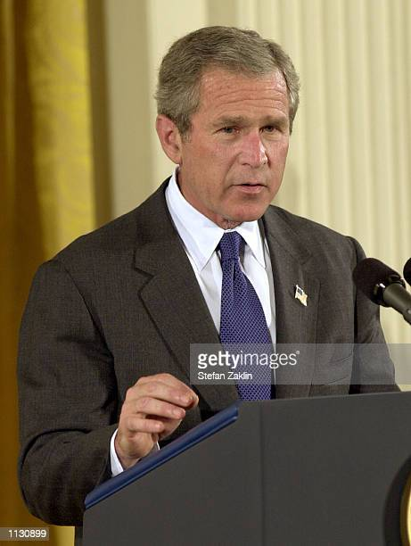 S President George W Bush speaks at a Medal of Honor ceremony for Humbert Roque Rocky Versace in the East Room of the White House July 8 2002 in...