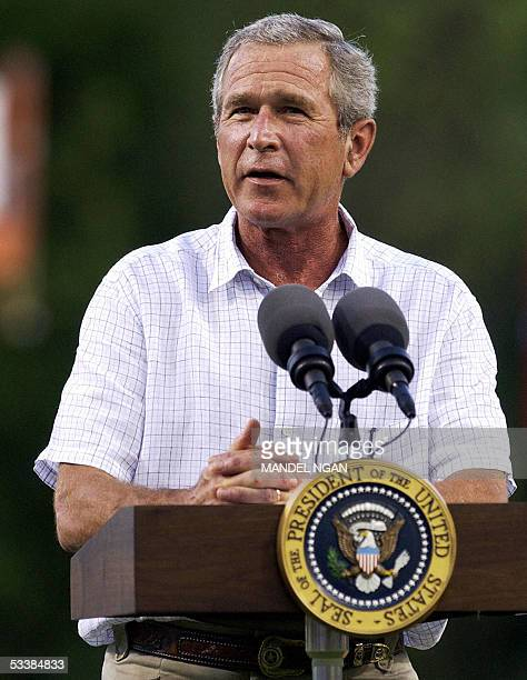 President George W Bush speaks before throwing out the first pitch of the game at the Little League Baseball Southwest Region Championship 13 August...