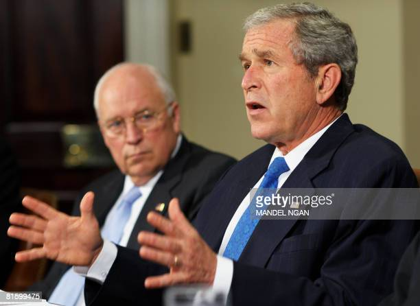 US President George W Bush speaks during a briefing on US Midwest flooding as Vice President Dick Cheney looks on June 17 2008 in the Roosevelt Room...