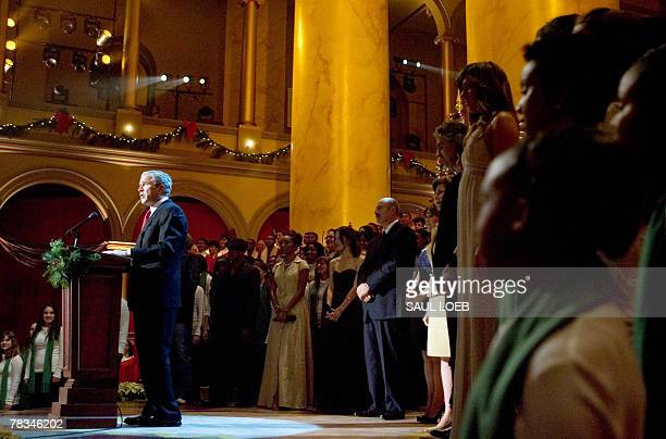 US President George W Bush speaks during a taping of a Christmas in Washington at the National Building Museum in Washington 09 December 2007 The...