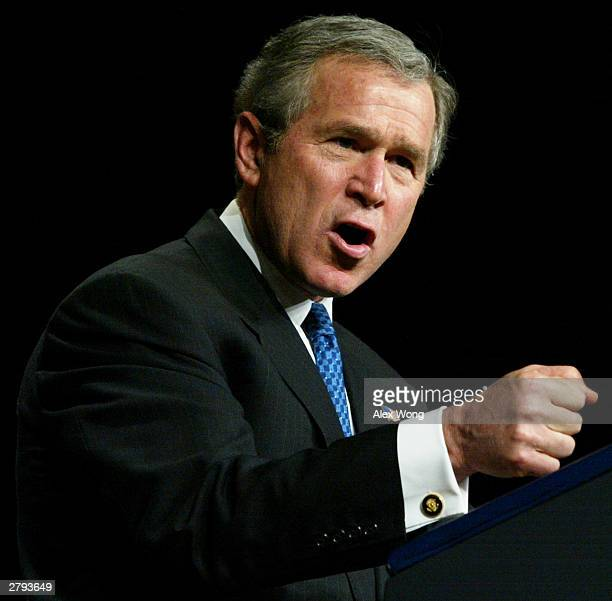 S President George W Bush speaks during the signing ceremony of a new Medicare legislation December 8 2003 at the DAR Constitution Hall in Washington...