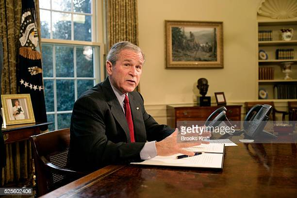 President George W Bush speaks from his desk after signing the Executive Order protecting American Taxpayers from Government Spending on Wasteful...