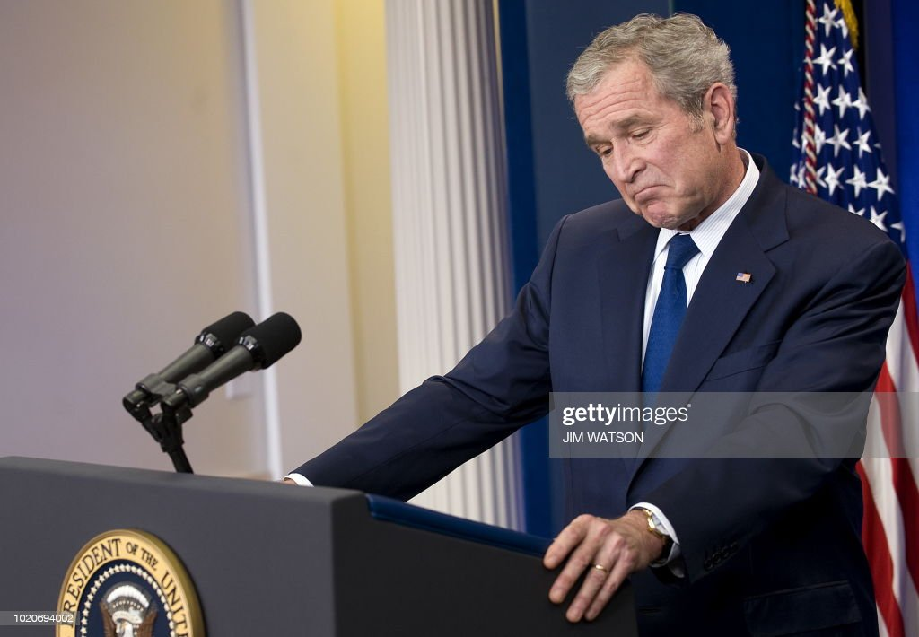 US President George W. Bush speaks from the Brady Press Briefing Room at the White House during his final press conference January 12, 2009, in Washington, DC. President Bush mounted a defiant and emotional defense of his 'good, strong record' on Monday, rejecting criticism of his 'war on terror' tactics and policy in Iraq and on the economy. AFP PHOTO/Jim WATSON