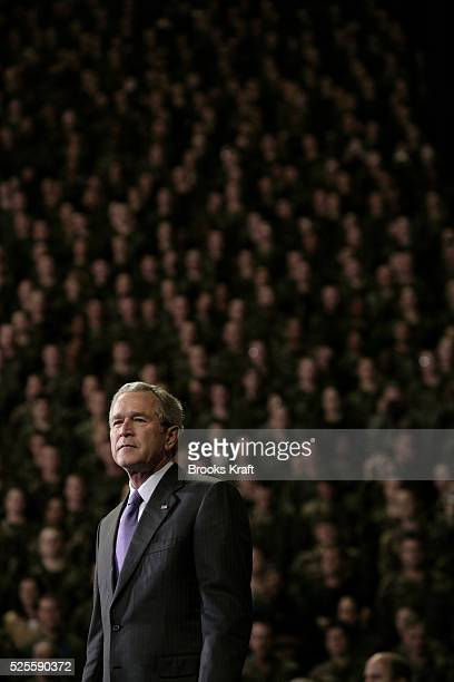 President George W. Bush speaks in front of soldiers who recently returned from Iraq at the Kansas State University in Manhattan, Kansas, January 23,...