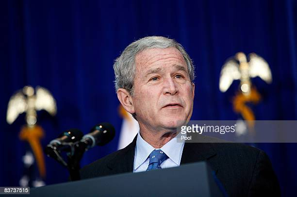 US President George W Bush speaks on aviation congestion and transportation safety at the US Department of Transportation on November 18 2008 in...