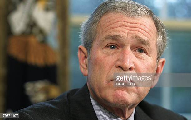 US President George W Bush speaks prior to signing an Executive Order titled 'Protecting American Taxpayers from Government Spending on Wasteful...