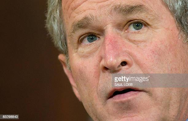 President George W. Bush speaks prior to signing the Andean Trade Preference Act Extension in the Eisenhower Executive Office Building adjacent to...
