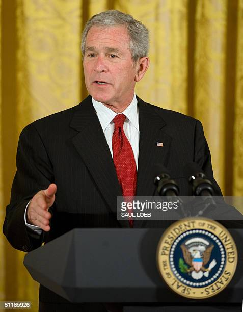 US President George W Bush speaks regarding Cuba's Independence Day in the East Room of the White House in Washington DC on May 21 2008 Bush on...