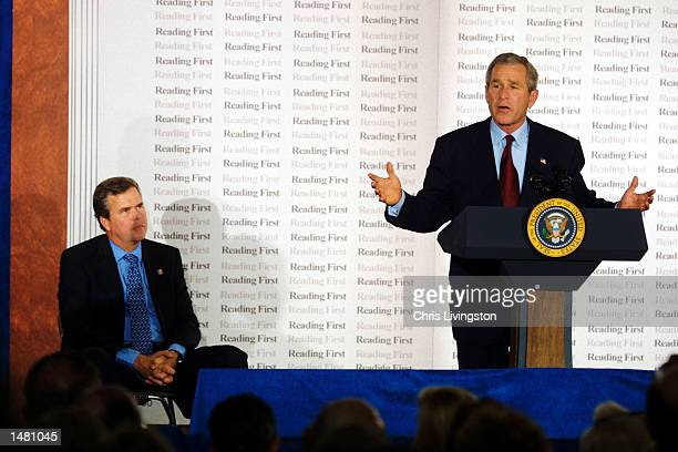 S President George W Bush speaks to a gathering of students and teachers as his brother Florida Governor Jeb Bush listens before headlining a $1...