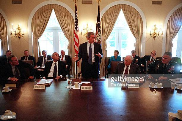 President George W. Bush speaks to his national security counsel team during a meeting in the Cabinet Room of The White House September 12, 2001 in...