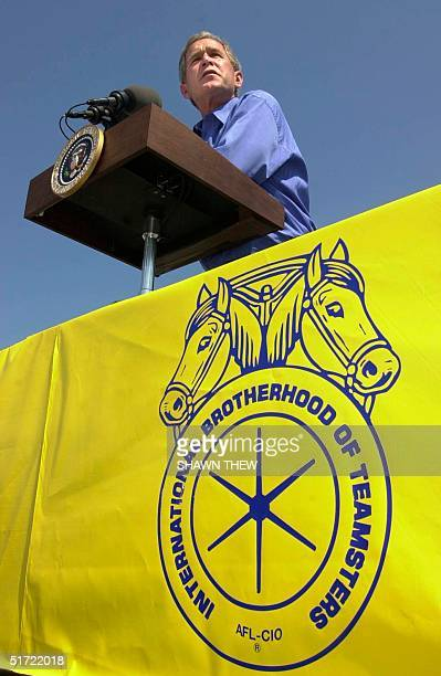 President George W Bush speaks to members of the Teamsters union during a barbecue at Teamsters Local 299 Headquarters 03 September 2001 in Detroit...