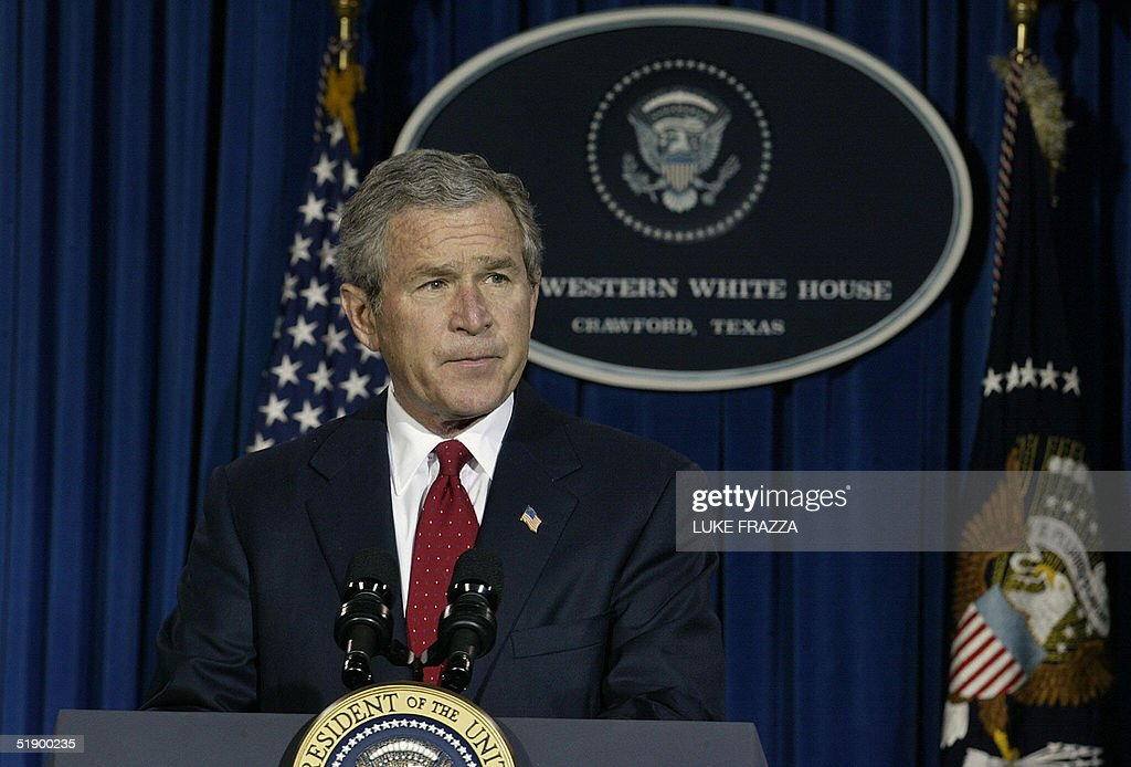 US President George W. Bush speaks to reporters 29 December 2004 near his ranch in Crawford, Texas about the US's response to the massive loss of life in Indian Ocean nations where more than 61,000 people have died after the violent crush of a 26 December 2004 tsunami. The US has pledged aid to the stricken nations. The Bushes are spending a week at the ranch before returning to Washington, DC 02 January 2005. AFP PHOTO/Luke FRAZZA