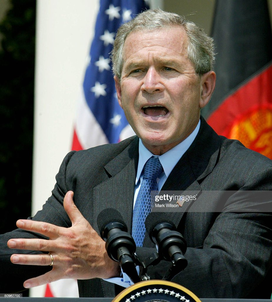 U.S. President George W. Bush speaks to reporters in the Rose Garden at the White House June 15, 2004 in Washington DC. Bush held the press conference with Afghan President Hamid Karzai after the two leaders met to discuss the war on terrorism.