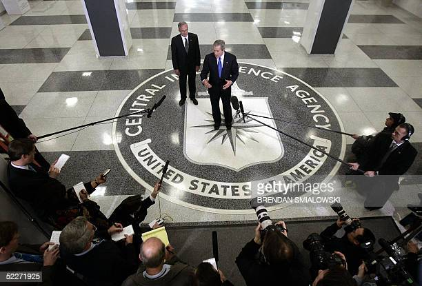 President George W Bush speaks to reporters with CIA Director Porter Goss at the headquarters of the Central Intelligence Agency 03 March 2005 in...