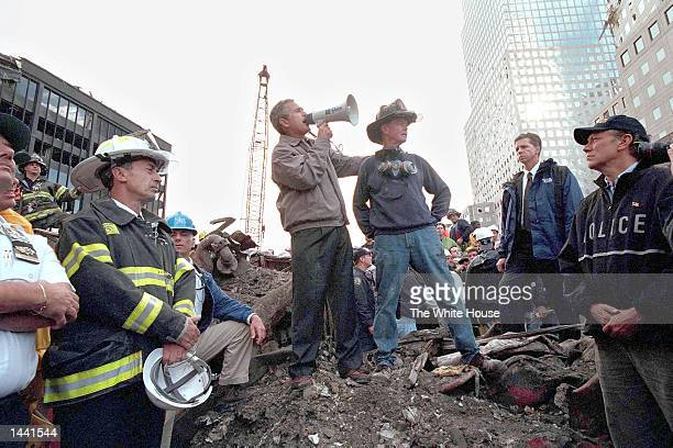 President George W. Bush speaks to rescue workers, firefighters and police officers from the rubble of Ground Zero September 14, 2001 in New York...
