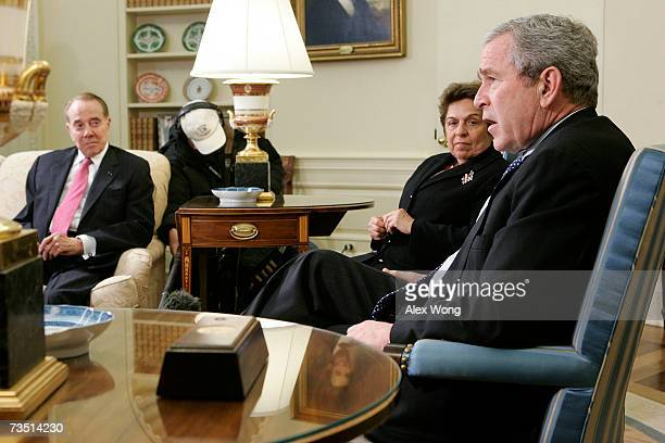 US President George W Bush speaks to the media as former Sen Bob Dole and former Secretary of Health and Human Services Donna Shalala look on after...