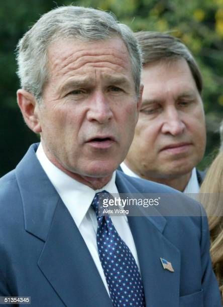 President George W. Bush speaks to the press as Russian Ambassador to the U.S. Yuri Ushakov listens prior to Bush's departure from the White House...