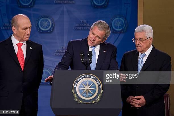 US President George W Bush speaks to those gathered as Israeli Prime Minister Ehud Olmert left and Palestinian President Mahmoud Abbas right listen...
