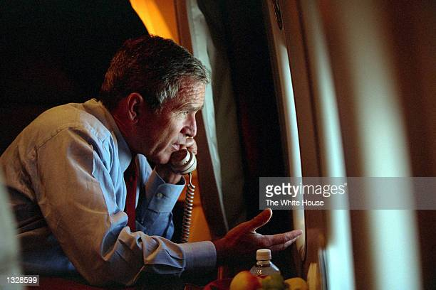 President George W. Bush speaks to Vice President Dick Cheney by phone aboard Air Force One September 11, 2001 after departing Offutt Air Force Base...