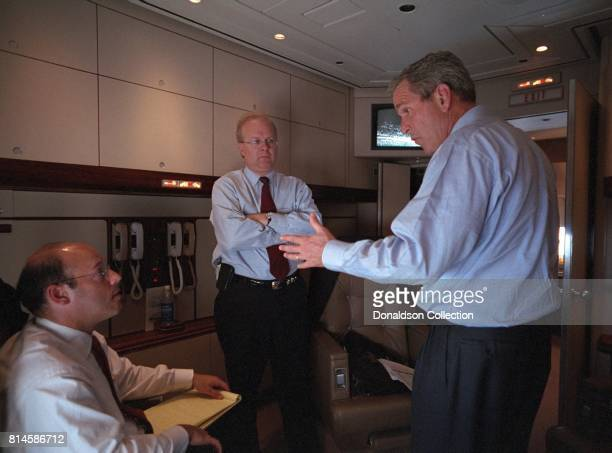 President George W Bush speaks with Ari Fleischer left and Karl Rove aboard Air Force One Tuesday Sept 11 during the flight from Offutt Air Force...