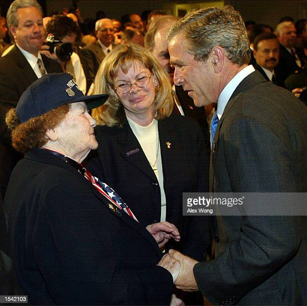 S President George W Bush speaks with Arlene Howard who's son George Howard a Port Authority police officer was killed during the Sept 11 attacks at...