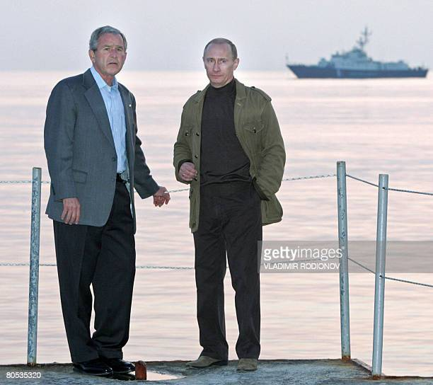 US President George W Bush speaks with his Russian counterpart Vladimir Putin during their meeting in the residence of Bocharov ruchei in Sochi on...