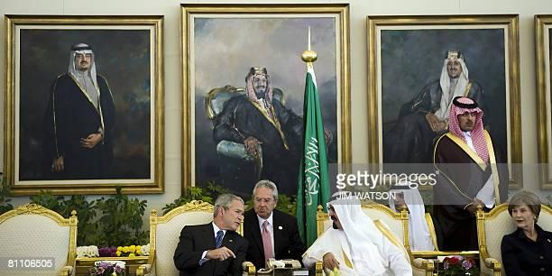 US President George W Bush speaks with King of Saudi Arabia Abdullah bin Abdul Aziz alSaud as First Lady Laura Bush looks on during an arrival...